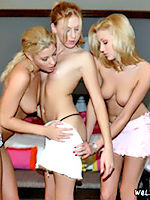 Two lesbians lure this sweet redhead back to their place for some fucking.