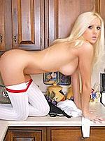 Blonde babe Megan Summers posing nude in the kitchen